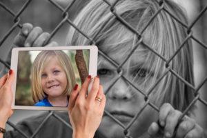 opposites-sad-child-cage
